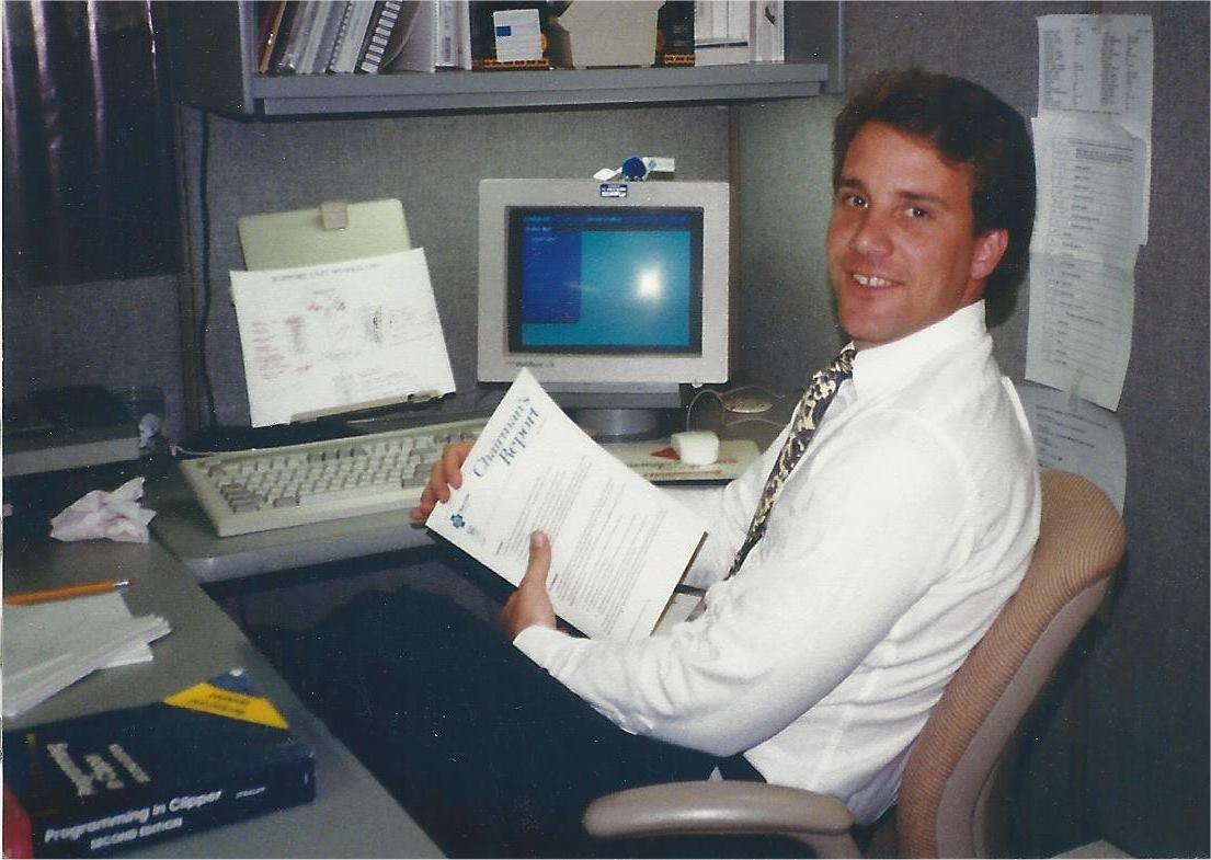 Image of me at Blue Cross with a book about Programming in Clipper