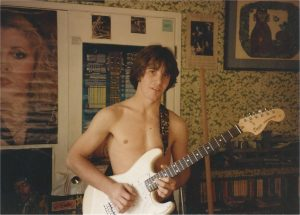 Image: Me playing my Stratocaster in my room in high school.